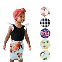 blumendruck bleistift röcke großhandel-Neue baby mädchen kleidung kinder blume gedruckt rock mädchen floral grid bleistift röcke kinder mädchen kleidung a line röcke