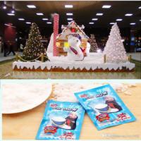 fake schnee dekorationen großhandel-Sofortiges künstliches magisches Schnee-Pulver Sofortige Schnee-magische Stütze DIY flaumiges saugfähiges Weihnachtshochzeits-Dekorations-weißes gefälschtes Schnee-Pulver