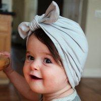 çocuklar şapkayı bağlar toptan satış-Bebek Çocuk Kış Şapka 13 Tasarım Katı Bow Tie Cap Çocuk Bebek Kızlar Erkekler Turban Şapka 1-3T 07 Caps Caps
