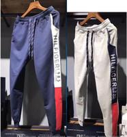 hombres cadena xl al por mayor-2019 hombres diseñador string Logo Pantalones de chándal Hombres de lujo mujeres Pantalones deportivos casuales Marca de moda Hombre estampado Pantalones de movimiento