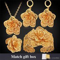 vintage-manschetten-set groihandel-Frauen Cuff Bracelets Gold 18K Platin überzogene hohle Blumen Ohrringe Ringe Halsketten Vintage afrikanische Schmucksets