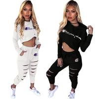 trajes sexy pretos venda por atacado-Campeão Com Capuz Duas Peças Roupas Mulheres Sexy Marca Moletom Com Capuz Manga Longa Curto Crop Top Bolso Buraco Longo Pant Set Branco Preto