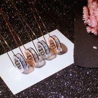 tierkreis edelsteine großhandel-Unendlichkeit Luxus Schmuck 100% 925 Sterling SilverRose Gold Fill Klar Topas CZ Diamant Edelsteine Tierzeichen Anhänger Hochzeit Halskette Für Frauen