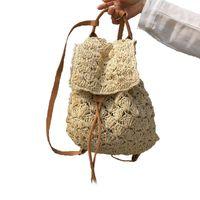 bolso de paja de playa con cordón al por mayor-Bolso de mujer Mochila Moda Hollow Out Woven Drawstring Summer Beach Mochilas Bolsos de mujer bolso de paja