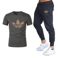 Wholesale two pieces clothing for sale - Mens Sets T Shirts Pants Men Brand Clothing Two Piece Suit Tracksuit Fashion Casual Tshirts Gyms Workout Fitness Sets Size M XL