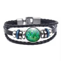 amuleto de metal pavo real al por mayor-Hebilla de metal de cristal encanto pulsera hecha a mano de plumas de pavo real joyería de moda negro tejido de múltiples capas pulsera trenzada