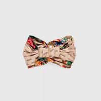 flor de la cinta coreana al por mayor-2019 Nueva versión coreana de Fashion Cross Silk Ribbon Estampado de flores Cinturón para el cabello, cabezas de pelo G, vendas, panecillos, cintas, bufandas Aro de pelo