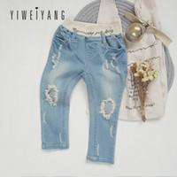neue mädchen mode jeans großhandel-2019 Sommer neue koreanische Ausgabe Female Bao Persönlichkeit Loch-Jeans In Kindermode-Pop-elastische dünne Jeans-Baby