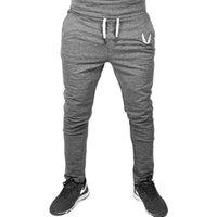 los hombres calzan pantalones deportivos al por mayor-Nuevo estilo de los hombres pantalones de gimnasio ajustados casuales Slim Fit bordado Stretch Urban Wind pantalones deportivos pantalones rectos