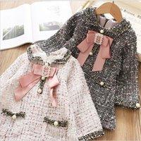 arcos de bolsos venda por atacado-Marca Girls Dress 2019 Outono Inverno Crianças vestido xadrez arco pérola de bolso Meninas Princess Dress Alto grau de roupa da criança T191007