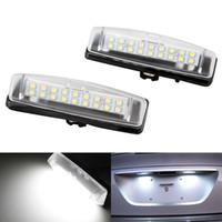 iluminación lexus al por mayor-2pcs / lot LED de la matrícula Lámparas 18LED COB gratuito para Toyota Camry Echo Prius Lexus IS LS GS ES RX Mitsubishi Luz Accesorios HHA93