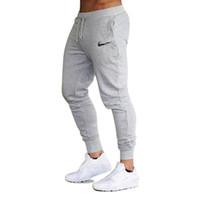 ingrosso cotone di marca-2018 nuovi uomini jogging marca pantaloni maschili pantaloni casual pantaloni da ginnastica uomini palestra muscolare cotone allenamento fitness hip hop pantaloni elastici