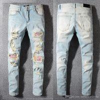 marcas famosas designer jeans venda por atacado-Nova marca de jeans famoso designer de moda calças AMIRI calças de brim dos homens calça buraco calças casuais calças de patch pés calças venda quente calças finas novo 1: 1