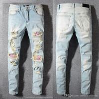 ingrosso jeans caldi di modo-Nuovi jeans di marca famosi pantaloni moda designer AMIRI jeans mens buco pantaloni casual patch pantaloni piedi pantaloni vendita calda pantaloni sottili nuovi 1: 1