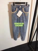 jeans filles haute qualité achat en gros de-Femmes Marque Poche Décorative Or Twist De Mode Jeans Pantalon En Denim Filles Régulières Haute Qualité Denim Pantalon Femme Coupe Ajustée Mouche Pantalon 19