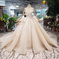 Wholesale custom wedding dress patterns resale online - 2019 Luxury PuffyBall Gown Wedding Dresses Sleeveless Open Keyhole Back Illusion Neckline Bow Applique Pattern Sequins Beach Bridal Gown