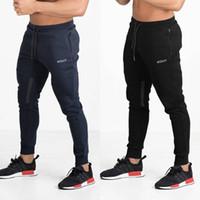 ingrosso pantaloni da escursionismo nero-2019 mens designer pantaloni elastici in vita traspirante nero sport fitness pantaloni casual escursionismo pantaloni da corsa M-2LX all'ingrosso