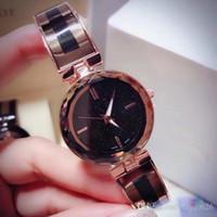 relojes de pulsera de superficie al por mayor-Nuevo modelo de moda para mujer Reloj de oro rosa de acero inoxidable Superficie estrellada Dial Reloj de pulsera de lujo para mujer Reloj de cuarzo clásico Relojes De Marca Mujer