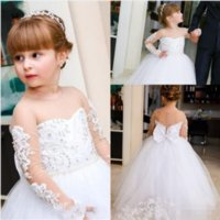 Wholesale birthday party dresses white resale online - Cute White Flower Girls Dresses Long Illusion Sleeves Lace Applique Beaded Jewel Neck Covered Buttons Bow Pearls Kids Birthday Party Gown