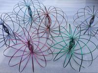 jouets en mouvement achat en gros de-Gros cadeaux Xmax en métal couleurs arc-en-ciel Toroflux Anneau d'écoulement Jouet Holographique par While Moving crée un anneau Flux Rainbow Toys Anneaux d'écoulement