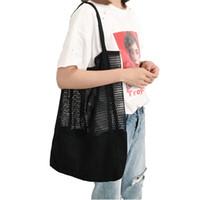 weiße strand-einkaufstaschen großhandel-Große Eimer Totes Aushöhlen Strandtasche Neue Frauen Mesh Handtaschen Faltbare Einkaufstasche Dame Casual Griff Taschen Schwarz Weiß