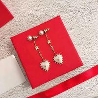 Wholesale letter d pendant online - European designer earrings heart shaped pearl long ear stud pendant earrings letter D Modelling women luxury brand earrings Valentine gift