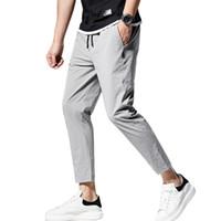 ingrosso pantaloni casual per gli uomini grigi-Pantaloni commerciali Pantaloni classici Mid elastico in vita degli uomini casuali di estate 9976 pantaloni degli uomini di moda respirazione Quick Dry Nero Grigio corso Pants