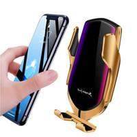 ingrosso porta telefono in vendita-Caricabatterie da auto wireless vendita calda R1 bloccaggio automatico per iphone Android Air Vent titolari di telefono rotazione di 360 gradi 10 W ricarica veloce con scatola