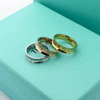 стильные подарки оптовых-2019 Стильный роскошный титан стали ювелирные изделия T письмо двойной алмазный паз кольца Engagment для женщин, мужчин подарок бесплатная доставка
