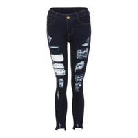 enge knöpfe jeans großhandel-Frauen Sexy Denim plus size Loch Röhrenjeans Reißverschluss Fly Enge Bleistift Hose Taste Lässige zerrissene Jeans für Frau drücken