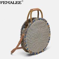 strohquasten strandtasche großhandel-FEMALEE Round Straw Handtasche Travel Knitting Strandtasche Quaste Bordered Umhängetaschen Design Damen Large Capacity Handtaschen Tote