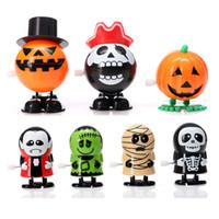 sorrir rosto crianças venda por atacado-7 estilos pulando halloween wind-up toy engraçado pvc abóboras fantasma crânio sorriso rosto boneca brinquedos caçoa o presente l329