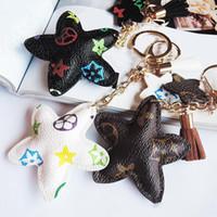 New Brand Keyrings PU Leather Pendant Bag Charms Cute Fashion Gift Keychain Ring Holder Flower Dog Giraffe Jewelry Car Key Chain Accessories