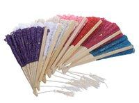 antike faltende fans großhandel-Chinese antiken Stil Spitze kontinuierlich leer Faltfächer 2 / up Batch Faltfächer Hand geschnitzt Bambus Handwerk Schleifen