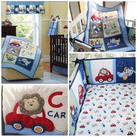 bebé establece monos al por mayor-Boy Pilot Juegos de cama de cuna de bebé Traje de cuatro piezas Color azul Monos animales lindos que imprimen el kit de la falda de la cama del niño 221dhE1