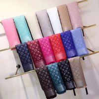 bufandas triangulares al por mayor-bufanda de marca nuevo diseño deslumbra color oro hilo bufanda de lana de punto chal de diseñador hombres y mujeres triángulo cuadrado 140 * 140 cm