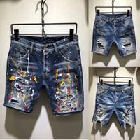 jeans cortos slim al por mayor-Hombres Ripped Slim Hole Jeans Diseñador de moda Straight Motorcycle Biker Jeans SHORTS Pantalones de mezclilla para hombre Cool jeans cortos