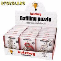 puzzles de fil achat en gros de-Utoysland 24pcs / set fil de métal Puzzles Casse-tête Iq Serrure Classique Intellectuelle Jouet Éducatif Pour Enfants Enfants Argent Y19070503