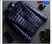 hombres con capucha de piel al por mayor-2018 nuevo diseñador de la venta caliente de lujo NIKE hombres abajo chaqueta sudaderas con capucha de piel abrigos de invierno cálido Parka hombre abajo abrigo para hombre