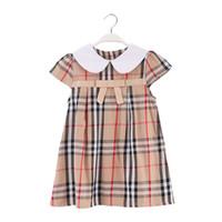 prinzessin kleidung farbabstimmung großhandel-Baumwolle Plaid Print Mädchen Kleider mit Bogen in der Front und Umlegekragen Design Kid Kleidung
