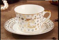tazas de café de cerámica de estilo europeo al por mayor-estilo europeo de hueso taza de porcelana restauración multi-estilo simples platillos plato taza de café de cerámica con el conjunto patrón con la cuchara