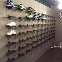 zapatero de metal al por mayor-Zapatos de pared superior de metal Estantes de soporte de exhibición Soportes de soporte de zapatos de ajuste de ángulo con almohadilla de goma antideslizante