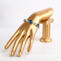 bogen armbänder ring großhandel-Hochwertige harz bogen modell schmuck rahmen schmuck rack ring armband halskette uhr display schmuck requisiten