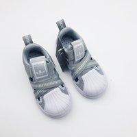 kreuzschlaufe freizeitschuhe großhandel-Kinder Designer Turnschuhe Luxus Cross Strap Schuhe Mode Jungen Outdoor Sportschuhe Casual Girl Flache Wanderer 6 Farben 2019 Kinder Schuhe Großhandel.