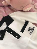 suéteres de manga corta para mujer. al por mayor-Elegante verano nueva moda mujer s manga corta del color del bloque carta bordado gire el cuello de seda de hielo de punto suéter tops camisa