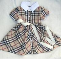 vestidos de niña estilo vintage al por mayor-Nuevo producto Chica Pure Cotton Lattice Tenis Falda Classic Baby Lapel Niños niñas vestido de manga corta Princesa Falda