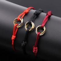 bracelete de corda vermelha venda por atacado-Moda amor Charme Pulseiras Cordas Vermelhas Macrame Corda Pulseiras Cubo Micro três círculo Zircão Pulseira Amor Mulher Homem Jóias 2401