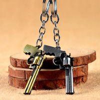 anel pistola pistola venda por atacado-Moda Em Miniatura Revolver Pistol Arma Modelo de moda Chaveiro Chave Anéis New Mini Gun chave Cadeia Para Homens Jóias Surpresa Presente