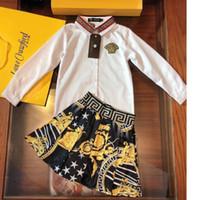 weißes bedrucktes hemd für kinder großhandel-Mädchenrock stellt Kinderdesignerkleidung weißes Revershemd + gedrucktes schwarzes Rock 2pcs Fallmädchensätze Größe 100-140cm ein