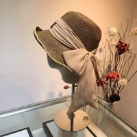 Wholesale black white straw hat men online - New trend men and women fashion light breathable wild beach straw hat organza ladies hats sinamay
